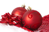 Red Christmas baubles on Santa hat — Stock Photo