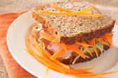 Tasty beef sandwich on wholewheat bread — Stock Photo