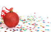Red Christmas bauble with stars — Stock Photo