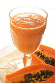 Glass of fresh papaya smoothie — Stock Photo