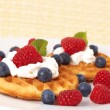 Belgian waffles with berries and cream — Stock Photo