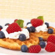 Belgiwaffles with berries and cream — Stock Photo #5312904