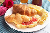 Croissant with cheese — Stock Photo