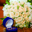Wedding bouquet and wedding rings — Stock Photo #5315186