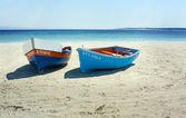 Boats on a secluded beach in South Africa — Stock Photo