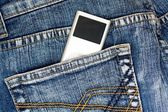Mp3 music player in jeans pocket — Stock Photo