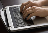 White male hands typing on a laptop keyboard — Stock Photo