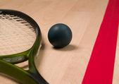 Squash racket and ball — Stock Photo