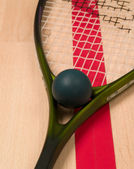Squash racket and ball — Stock Photo