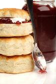 Scone sand pot of jam — Stock Photo