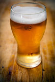Beer on wooden background — Stock Photo