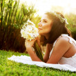 Happy bride on the grass - Stock Photo
