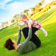 Mather & baby daughter playing — Stock Photo