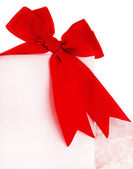 Beautiful red bow over blank card — Stock Photo