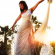 Happy bride over sunset — Stock Photo