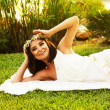 Happy bride on the grass — Stock Photo