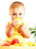 Little baby eating apple — Stok fotoğraf