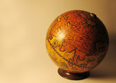Ball of the world with a old map — Stock Photo