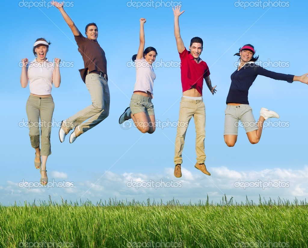 Jumping young happy group in meadow blue sky outdoor — Photo #5115720