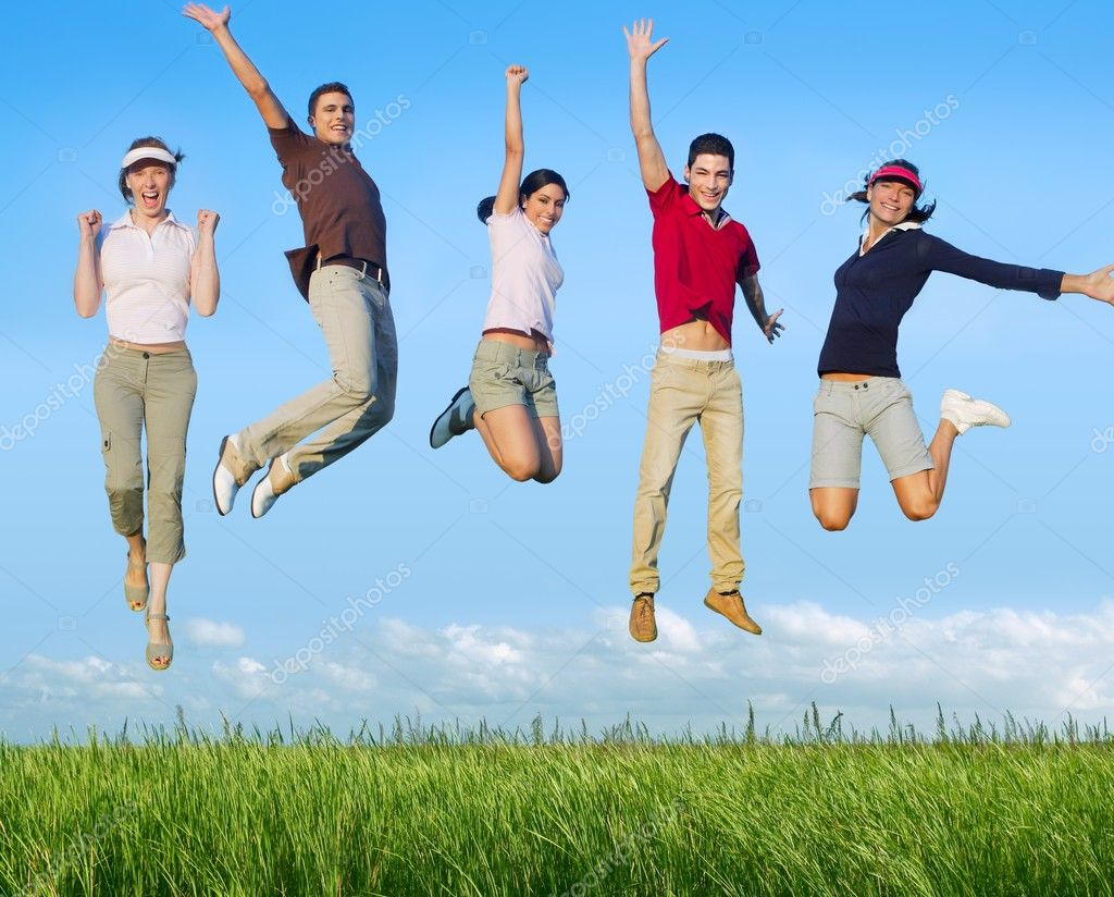 Jumping young happy group in meadow blue sky outdoor — Stok fotoğraf #5115720