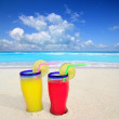 Royalty-Free Stock Photo: Beach cocktails yellow red in caribbean tropical sea