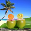 Fresh coconuts straw cocktails tropical palm tree beach — Stock Photo