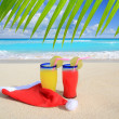 Beach cocktails with Santa christmas red winter hat — Stok fotoğraf