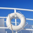 Boat buoy white hanged in railing summer blue sky — Stock Photo #5123092