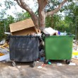 Dirty trash containers messy dirt everywhere - 图库照片