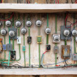 Electric meter messy electrical wiring installation - Stock Photo