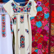 Chiapas Mayan dress embroidery and serape - Stock Photo