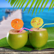 Coconuts straw cocktails in tropical caribbean sea pier — Stock Photo