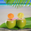 Fresh tender green coconuts straw beach cocktails — Stock Photo