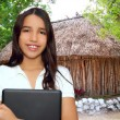 Stock Photo: Brunette teen student indilatin holding laptop