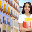 Brunette student young girl teen latin holding books — Stock Photo #5125398