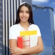 Brunette student young girl teen latin holding books — Stock Photo