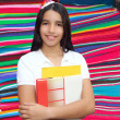 Brunette student young girl teen latin holding books — Stock Photo #5125417