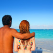 Ethnic mixed couple man woman beach vacation — Stock Photo