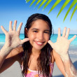 Llatin teen girl playing beach smiling sandy hands — Stock Photo #5125453