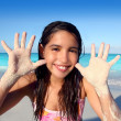 Llatin teen girl playing beach smiling sandy hands — Stock Photo