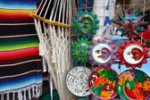 Mexican handcrafts hammock serape and ceramics — Stock Photo
