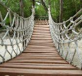 Adventure wooden rope jungle suspension bridge — Stock Photo