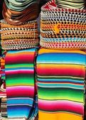 Mexican serape colorful stacked and charro hats — Stock Photo