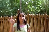 Indian girl waving greeting in jungle south american — Stock Photo