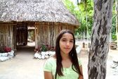 Indian girl in jungle palapa hut house rainforest — Stock Photo