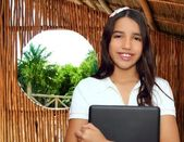 Brunette teen student indian latin holding laptop — Foto Stock