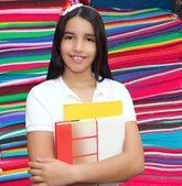 Brunette student young girl teen latin holding books — Stock Photo