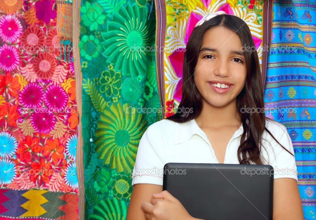 Brunette teen student indian latin holding laptop Mexican embroidery serape