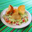 Guacamole mexican salad with nachos totopos - Stock Photo