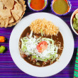 Mole enchiladas mexican food with chili sauces — Stock Photo #5282667